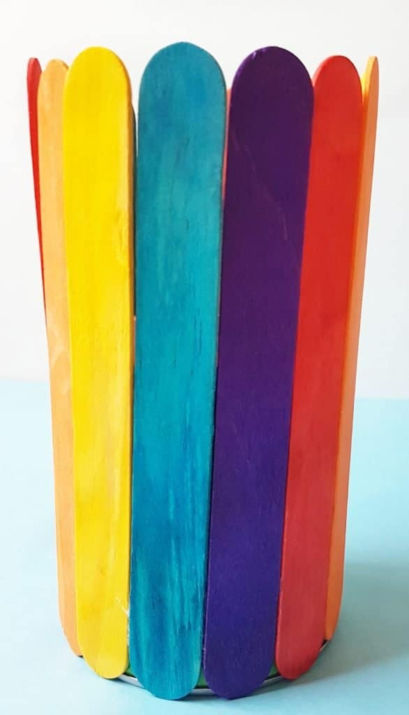 Make this gorgeous Rainbow Popsicle Stick Vase this Mother's Day. #popsiclecraft #rainbowcraft #kidscrafts #mothersdaycraft