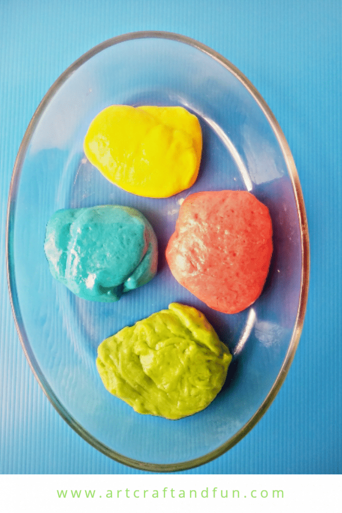 Make Rainbow Edible Slime today. This easy edible slime recipe uses marshmallows. The colorful marshmallows give this slime its pretty Rainbow colors. Sure to be a favorite of everyone! #rainbowslime #edibleslime #slime